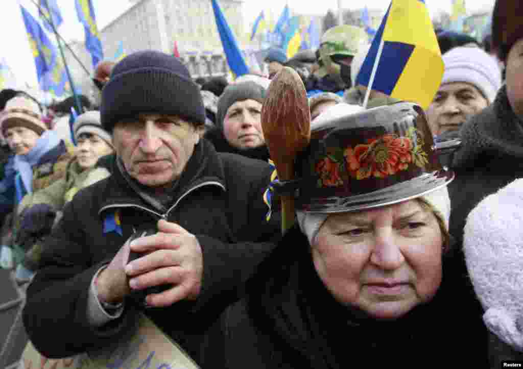 Pro-European protesters look on during a rally in Independence Square, Kyiv, Ukraine, Jan. 19, 2014.