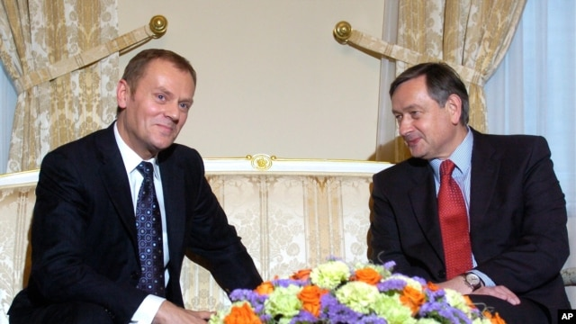 FILE - Polish Prime Minister Donald Tusk, left, talks with Slovenian President Danilo Turk, Presidential palace, Ljubljana, Slovenia, March 2008.