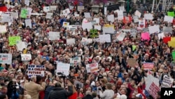 The crowd cheers during a teacher rally at the state Capitol in Oklahoma City, Monday, April 2, 2018. (AP Photo/Sue Ogrocki)