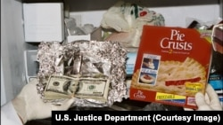 Photo of money government said it found in food boxes in freezer of former Congressman William Jefferson.
