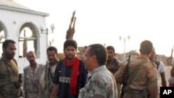 Yemen soldiers are seen in the southern city of Zinjibar, capital of Abyan province, on September 10, 2011, which was freed after being overrun by Al-Qaeda suspects in May.