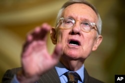 FILE - Senate Minority Leader Sen. Harry Reid of Nev. speaks during a news conference on Capitol Hill in Washington, Sept. 16, 2015.