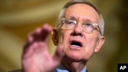 "FILE - Senate Minority Leader Harry Reid of Nevada says the legislation on sanctuary cities ""paints all immigrants as criminals."""