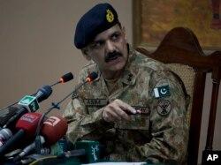Pakistan's army spokesman Major-General Asim Bajwa briefs the media about a Taliban attack on a school in Peshawar, Pakistan, Dec. 16, 2014.