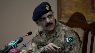 FILE - Pakistan's army spokesman Major-General Asim Bajwa briefs the media about a Taliban attack on a school in Peshawar, Pakistan, Dec. 16, 2014.