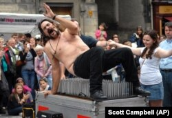 Magician Timothy Terror gets off a bed of nails as he performs on the first day of the Edinburgh Fringe Festival, Aug 2010. (AP /Scott Campbell)