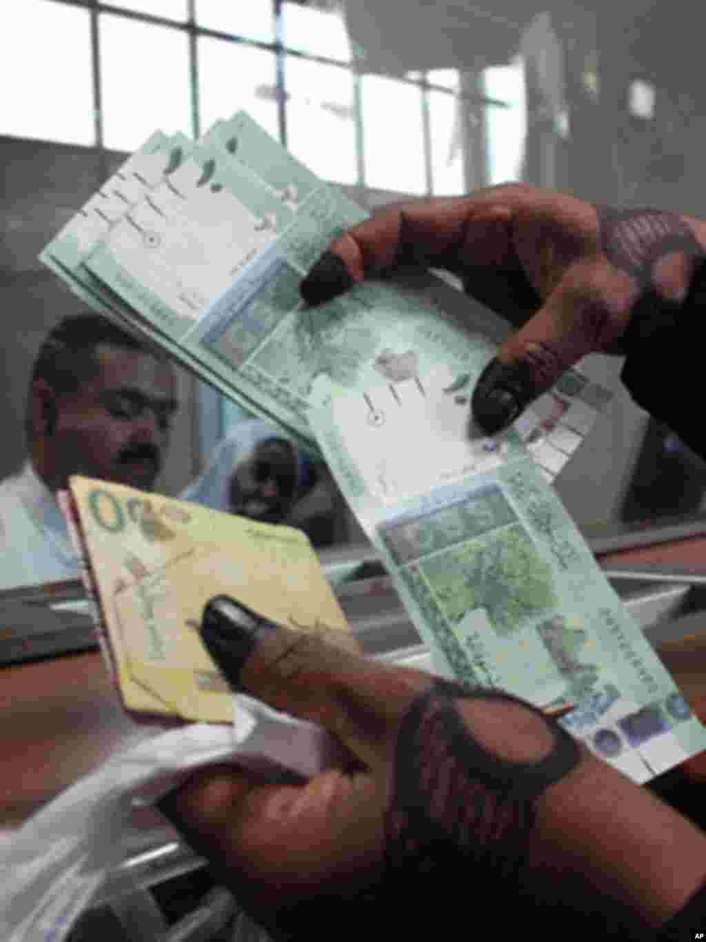 President Kiir should know the difference between cows and money. How come he kept money in his compound like cows and yet we have safe places like banks for him to save his save his money? Keeping money in the office is a sign of corruption. - James Ruei Majok in Unity state A woman displays Sudan's new currency at the central bank in Khartoum, Sudan, in July 2011.