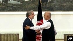 Президентський кандидат Абдулла Абдулла (л) і новий президент Ашраф Гані Ахмедзай