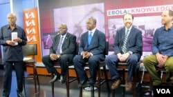 "FILE - VOA ""Straight Talk Africa"" host Shaka Ssali, left, leads an Ebola discussion with Ambassador H.E. Bockari K. Stevens of Sierra Leone, Dr. Malonga Miatudila, and Ebola survivors Rick Sacra and Ashoka Mukpo, Nov. 19, 2014."