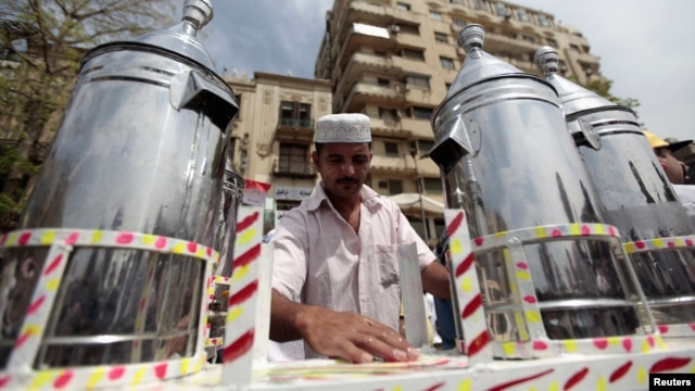 Waleed Ahmed el-Sayed, 31, who received a BA in social services from Assyiut University in 2004, sells juice in Cairo'sTahrir square, May 4, 2012.