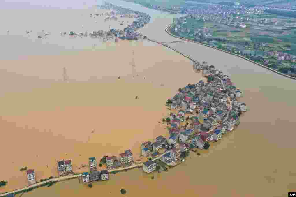 This image from above shows flooded streets and buildings after a dam failure due to flooding in Jiujiang in China's central Jiangxi province.