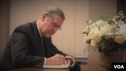 William Cohen, signs the condolence book for His Majesty King Bhumibol Adulyadej.