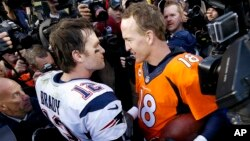 New England Patriots quarterback Tom Brady, left, and Denver Broncos quarterback Peyton Manning speak to one another following the NFL football AFC Championship game between the Denver Broncos and the New England Patriots, Jan. 24, 2016.