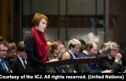 FILE - The Agent of Ukraine, Olena Zerkal, speaks on opening day of hearings in the case of Ukraine v. Russian Federation at the International Court of Justice, The Hague, March 6, 2017.