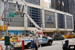 New York City police install security cameras near the Hilton Hotel in New York, Nov. 4, 2016, where Donald Trump organizers will gather on election night. The police and the FBI say they are assessing information they received of a possible al-Qaida attack against the U.S. on the eve of Election Day.