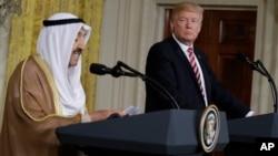 President Donald Trump listens while Kuwait leader Sheikh Sabah Al-Ahmad Al-Jaber Al-Sabah speaks during a news conference at the White House in Washington, Sept. 7, 2017.