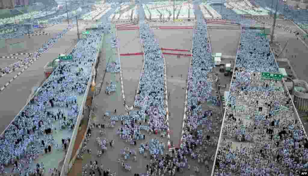 "Muslim pilgrims arrive to throw pebbles at pillars during the ""Jamarat"" ritual, the stoning of Satan, in Mina near the holy city of Mecca, Saudi Arabia."