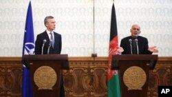 Afghan President Ashraf Ghani (R) speaks as NATO Secretary General Jens Stoltenberg listens during a joint press conference at the Presidential Palace in Kabul, Afghanistan, March 15, 2016.