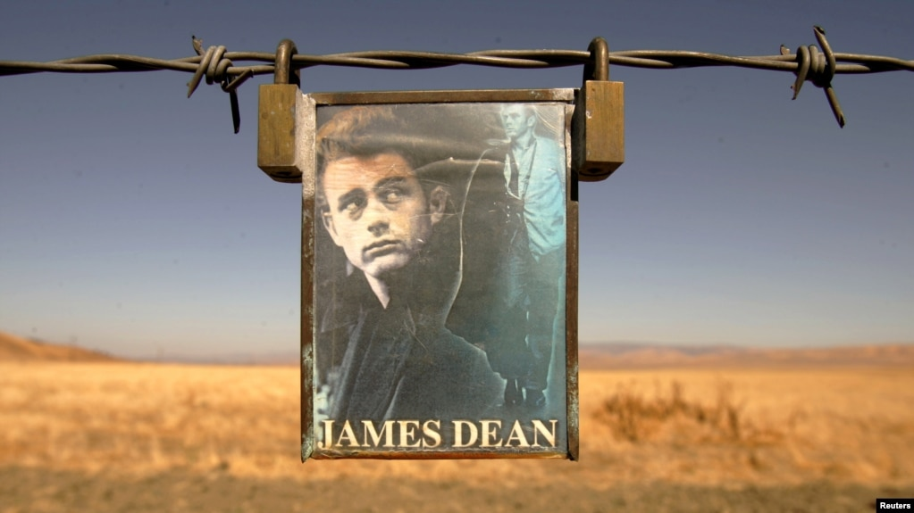 FILE PHOTO: A portrait of U.S. actor James Dean hangs from a fence near the intersection of Highways 46 and 41 near Cholame, California September 30, 2005.