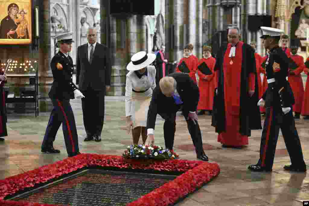 U.S President Donald Trump, accompanied by his wife Melania and Britain's Prince Andrew, second left, places a wreath on the Grave of the Unknown Warrior during a tour of Westminster Abbey in central London, June 3, 2019.