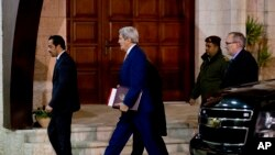 U.S. Secretary of State John Kerry, center, arrives to the West Bank city of Ramallah, Tuesday, Nov. 24, 2015, to meet with Palestinian President Mahmoud Abbas.