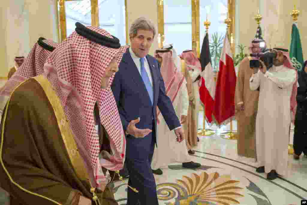 U.S. Secretary of State John Kerry speaks with Saud bin Faisal bin Abdulaziz al-Saud, Foreign Minister of Saudi Arabia, during a meeting of Gulf foreign ministers at Riyadh Air Base, March 5, 2015.