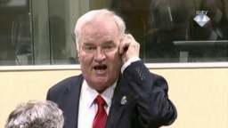 Former Bosnian Serb military commander Ratko Mladic is seen during an angry outburst at the Yugoslav War Crimes Tribunal in The Hague, Netherlands, Nov. 22, 2017.
