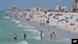 People enjoy their time in the sun on Clearwater Beach in Clearwater, Florida on March 2, 2021. (AP File Photo)