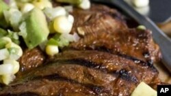 This photo taken Aug. 16, 2009 shows a locally raised flatiron steak will find a good home in this Chipotle-marinated Flatiron Steak with Avocado-corn Relish. The flatiron steak is also known as a top blade steak and is a nicely marbled cut from the shoul