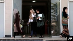 """FILE - Afghan female students leave Kardan University in Kabul, Afghanistan, Sept. 15, 2013. """"By targeting schools, terrorists take aim at a nation's best and brightest, and more broadly at its future,"""" one analyst says."""
