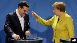Grčki premijer Aleksis Cipras i nemačka kancelarka Angela Merkel na konferenciji za novinare u Berlinu