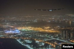 Solar Impulse 2, the solar powered plane, piloted by Swiss pioneer Bertrand Piccard, is seen before landing in Abu Dhabi to finish the first around the world flight without the use of fuel, United Arab Emirates July 26, 2016.