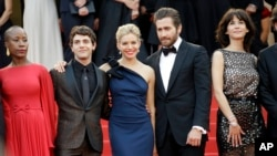 From left, Rokia Traore, Xavier Doran, Sienna Miller, Jake Gyllenhaal and Sophie Marceau arrive for the opening ceremony and the screening of the film 'La Tete Haute' at the 68th international film festival, Cannes, southern France, May 13, 2015. (Photo by Joel Ryan/Invision/AP)