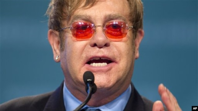 Sir Elton John speaks at the International Aids Conference in Washington, July 23, 2012.