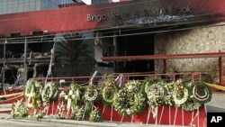 A makeshift memorial of funeral wreaths line the circular driveway of the Casino Royale in Monterrey, Mexico, August, 27, 2011.