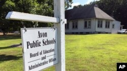 FILE - The board of education offices in Avon, Conn. is seen in this July 12, 2019 photo.