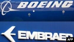 Kombinasi foto logo Boeing dan Embraer, 21 Desember 2017.