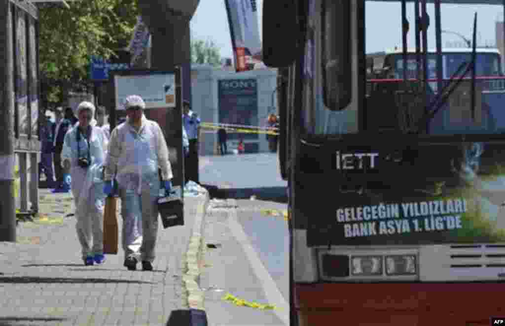 Forensic experts work at the scene after a bomb exploded at a bus stop during rush hour in Istanbul, Turkey, Thursday, May 26, 2011. Seven people were injured as several ambulances rushed to the scene on a multi-lane thoroughfare in a busy commercial sect