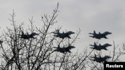 FILE - Russian Su-30 jet fighters fly in formation over Krasnoyarsk, Russia.