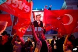 FILE - Supporters of Turkey's President Recep Tayyip Erdogan gather for a rally in Ankara, Turkey, April 16, 2017