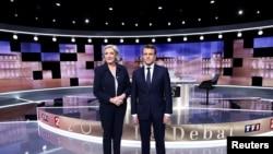Marine Le Pen et Emmanuel Macron avant leur débat télévisé sur TF1 et France 2, La Plaine-Saint-Denis, le 3 mai 2017.