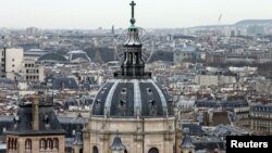 FILE - A city view shows the dome at La Sorbonne University as part of the skyline in Paris, France, March 30, 2016.