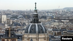 FILE- A city view shows the dome at La Sorbonne University as part of the skyline in Paris, France, March 30, 2016.