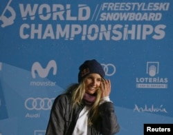 Gold medalist Anna Gasser of Austria reacts during the medal ceremony for Women's Big Air at the FIS Snowboarding and Freestyle Skiing World Championships, Sierra Nevada, Spain, March 17, 2017.
