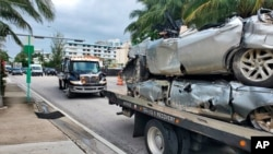 Vehicles that were pulled from the rubble of the Champlain Towers South are transported on Saturday, July 10, 2021 in Surfside, Fla. Surfside Mayor Charles Burkett said crews were making good progress, especially in clearing debris from the section…