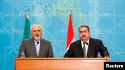 FILE- Iran's Foreign Minister Mohammed Javad Zarif (L) speaks during a joint news conference with Iraq's Foreign Minister Hoshyar Zebari (R) in Baghdad, Jan. 14, 2014