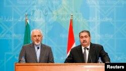 지난 달 14일 이라크 바그다드에서 자바드 자리프 이란 외무장관(왼쪽)과 호스야르 제바리 이라크 외무장관이 회담 후 공동 기자회견에 참석했다. (자료사진)