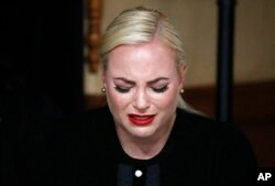 FILE - Meghan McCain, daughter of, Sen. John McCain, R-Ariz. cries during a memorial service at the Arizona Capitol on Wednesday, Aug. 29, 2018, in Phoenix.