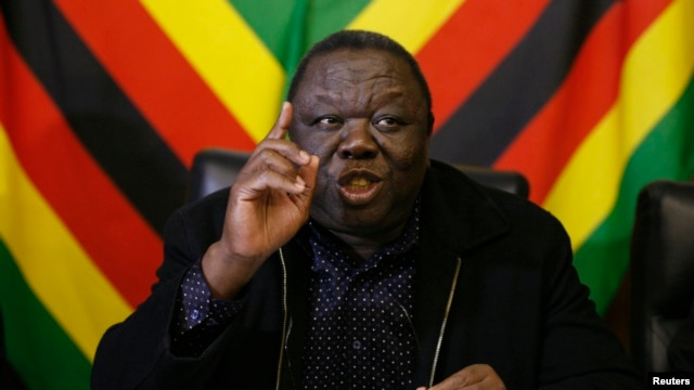 Zimbabwe Prime Minister and leader of the opposition Movement for Democratic Change Morgan Tsvangirai speaks at a news conference in Harare, June 13, 2013.