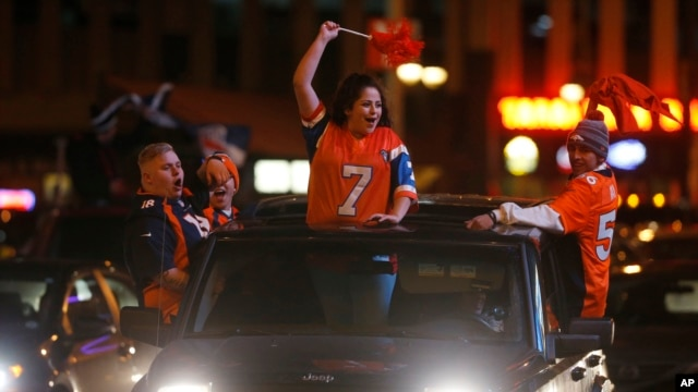 Denver Broncos fans celebrate their team's victory over the Carolina Panthers in Super Bowl 50 late Sunday, Feb. 7, 2016, in Denver.